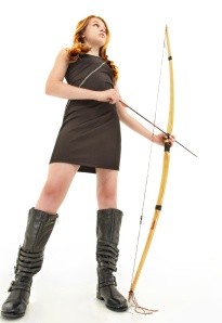 Tween Girl with Handmade Bow and Arrow Over White