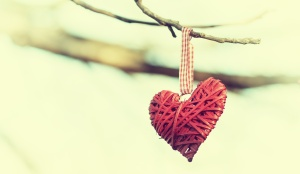 Two hearts on the branch of a tree, retro look