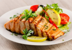 Grilled Salmon with fresh salad and lemon. Selective focus