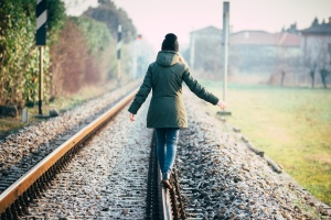 Girl walking on rail