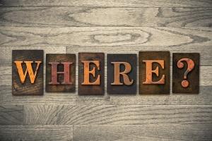 "The word ""WHERE?"" written in vintage wooden letterpress type."