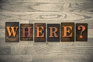 "The word ""WHERE?"" written in vintage wooden letterpress type."